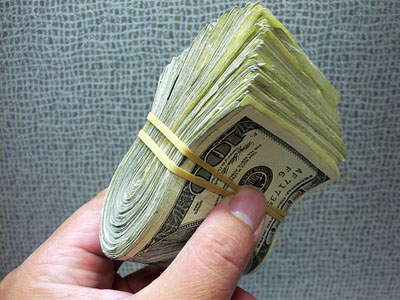 cash_wad-of-money-in-hand